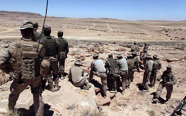 US Marines monitor Eager Lion multinational military maneuvers in Quweira, south of Amman, Jordan, on June 18, 2013. (photo credit: AP/Maya Alleruzzo, File)