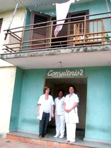 A group of men standing in front of a building  Description automatically generated with low confidence