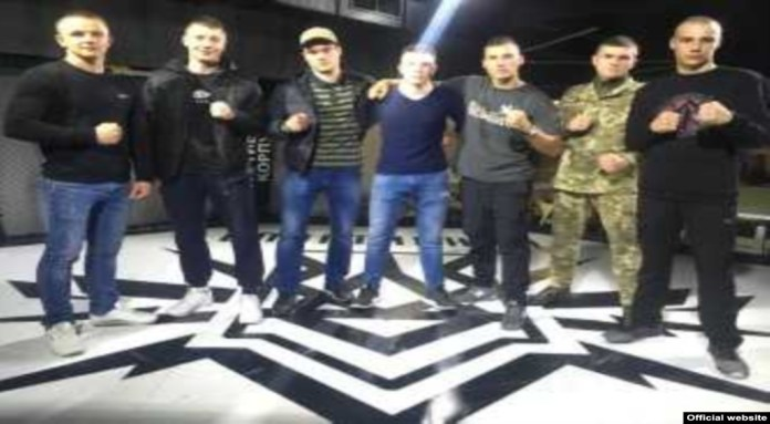 American Robert Rundo (center) with Ukrainian Azov Battalion members at the Reconquista Club in Kyiv on April 27.