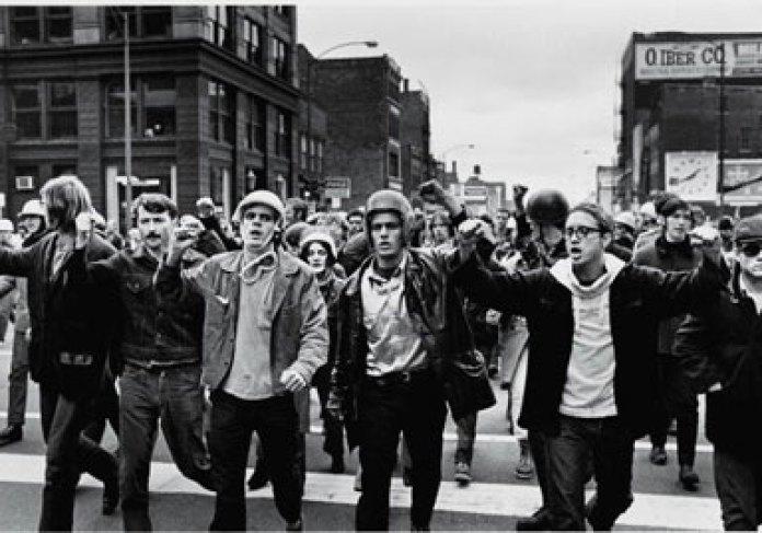 [Image: a-group-of-people-walking-on-a-street-de...C487&ssl=1]