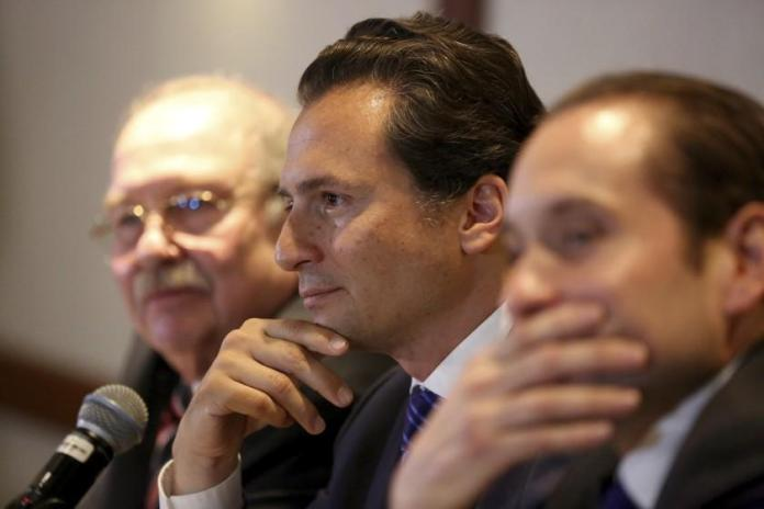 Flanked by his lawyers, Emilio Lozoya, former head of Mexico's state-owned oil company Pemex