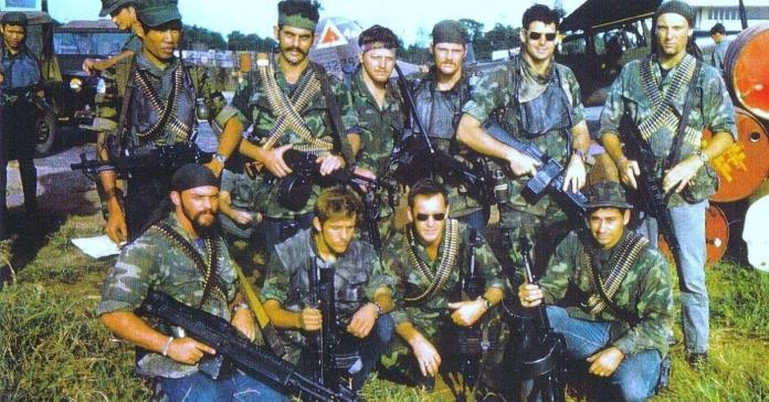 A group of people in military uniforms  Description automatically generated with low confidence