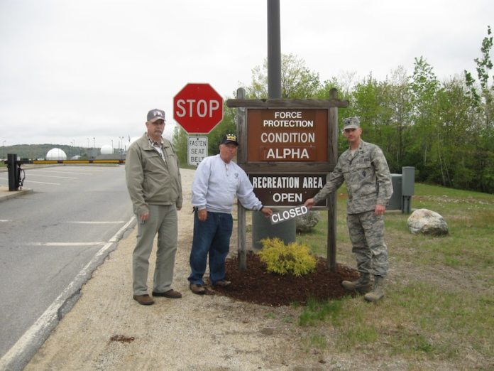 Dick Gamache and Herb Dixon, Department of Defense cardholders, stands with Lt. Col. David Hanson, 23rd Space Operations Squadron commander, after officially reopening the recreation area on New Boston Air Force Station. The area was previously closed due to an Air Force unexploded ordnance remediation project. (Courtesy photo)