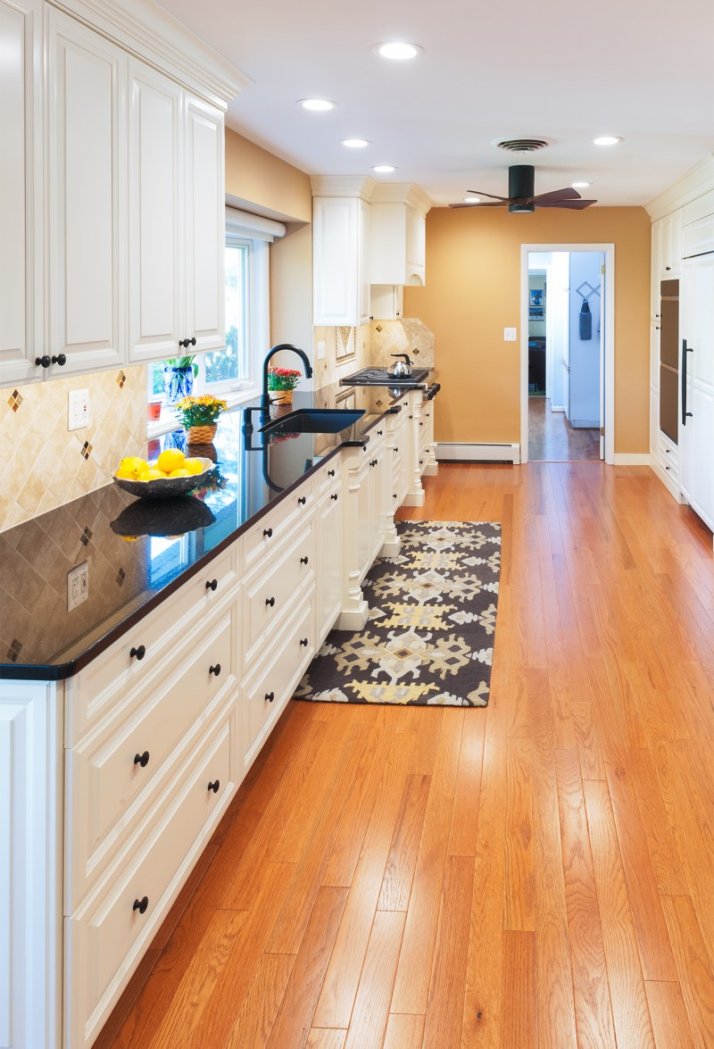 White cabinets and black countertop