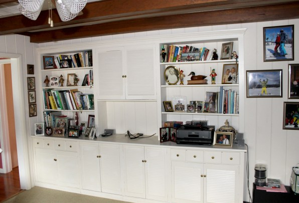 white louvered bookcase