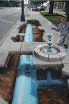 Water infrastructure as sidewalk art