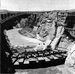 The Colorado River begins to back up behind Glen Canyon Dam during construction