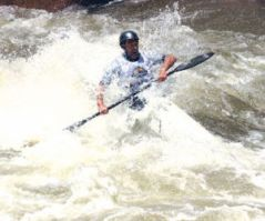 Tom Lawson runs through Cottonwood Rapid Sunday during the Downriver Classic, a 26-mile whitewater race from Coors Boat Ramp in Salida to Cotopaxi. Lawson placed third in the men's classic with a time of 2 hours, 17 minutes, 3 seconds.