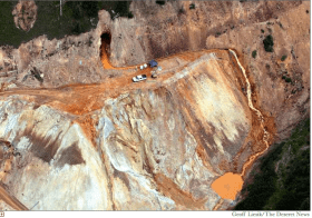 Wastewater continued to stream out of the Gold King Mine on Tuesday [August 11, 2015] near Silverton, several days after a rush of 3 million gallons of it flooded Cement Creek and the Animas River. At the top of the photo is the mine's opening, where an Environmental Protection Agency cleanup team was working with heavy machinery Aug. 5 and hit an earthen wall that had millions of gallons of water built up behind it