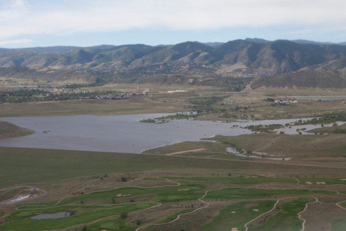 Following heavy rains which fell mid-Septembe 2013 r in Colorado, the pool elevation at the Bear Creek reservoir rose several feet. At 4 a.m., Sept. 15, the reservoir pool elevation surpassed its previous record elevation of 5587.1 feet, and peaked at a pool elevation of 5607.9 ft on Sept. 22, shown here. Bear Creek Dam did what it was designed to do by catching the runoff and reducing flooding risks to the hundreds of homes located downstream.