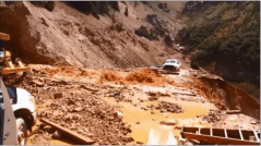 This image was taken during the peak outflow from the Gold King Mine spill at 10:57 a.m. Aug. 5, 2015. The waste-rock dump can be seen eroding on the right. Federal investigators placed blame for the blowout squarely on engineering errors made by the Environmental Protection Agency's-contracted company in a 132-page report released Thursday [October 22, 2015]
