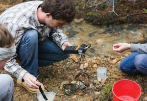 Junior environmental engineering students measure water quality parameters for their field session client, Clear Creek Watershed Foundation. (Credit: Deirdre O. Keating)