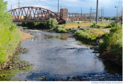 The South Platte River runs by a utility plant near I-25 in Denver. The South Platte River runs by an electricity plant near I-25 in Denver. A project proposed by the South Platte Regional Opportunities Water Group would allow Front Range water managers to maximize the reuse of Colorado River water. Photo credit: Lindsay Fendt/Aspen Journalism