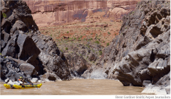 A boater, Steve Skinner, makes his way toward Skull Rapid in Westwater Canyon. Future potential releases of water from Blue Mesa Reservoir down the Gunnison River and into the Colorado River could alter flows in Westwater, and boost water levels in Lake Powell. Photo credit: Aspen Journalism/Brent Gardner-Smith