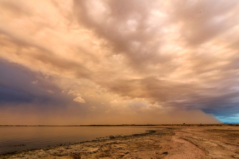 Just above the horizon here, a haboob (dust storm) can be seen heading north. This was shot at what remains of the Salton Sea Naval Test Station. Photo credit: slworking2/Flickr