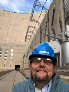 Coyote Gulch in a borrowed hard hat on the deck of the Arizona powerhouse at Hoover Dam on December 13. 2019.