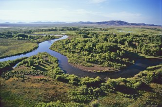 The Conejos River (right) joins the Rio Grande on the 3,200-acre Cross Arrow Ranch southeast of Alamosa. Photo By: John Fielder via Water Education Colorado