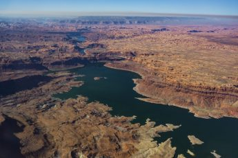 Lake Powell is seen in a November 2019 aerial photo from the nonprofit EcoFlight. Keeping enough water in the reservoir to support downstream users in Arizona, Nevada and California is complicated by climate change, as well as projections that the upper basin states of Colorado, Utah, Wyoming and New Mexico will use as much as 40% more water than current demand. A recent white paper from a lineup of river experts calls those use projections into question. CREDIT: ECOFLIGHT via Aspen Journalism
