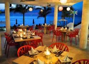 Dining ocean side at night.