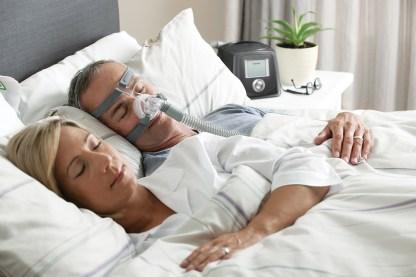 Male & Female Sleeping Using CPAP Machine - cpapRX