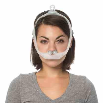 Woman Wearing CPAP Nasal Pillows Mask