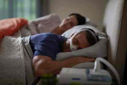 Man Sleeping with CPAP - cpapRX
