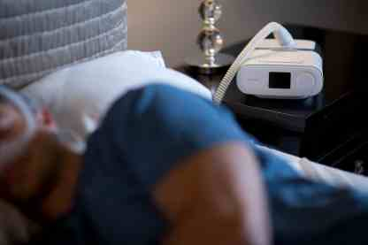 DreamStation CPAP Machine on Nightstand - cpapRX