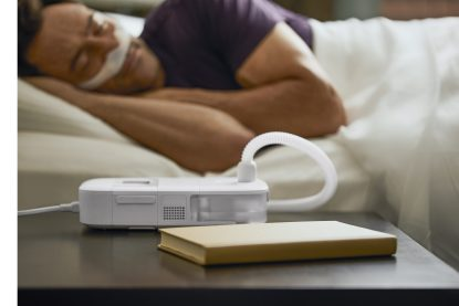 CPAP Machine on Nightstand - cpapRX
