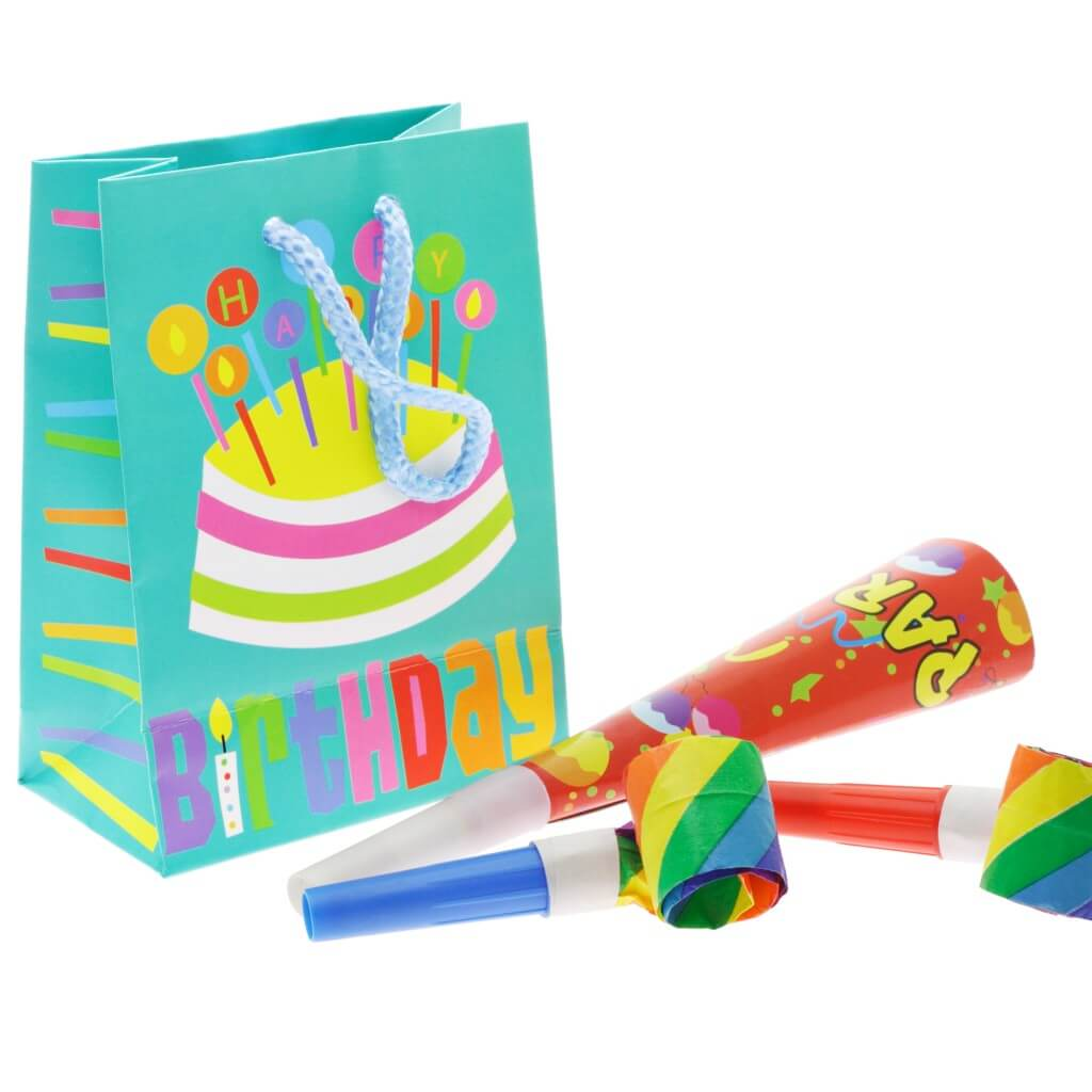 Colorful gift bag and party blowers on white background