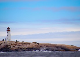 Lighthouse and tourists, Peggy's Cove, Nova Scotia.
