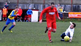 Wearn runs through the Afan Lido defence to round the goalkeeper and score for the Bulldogs.