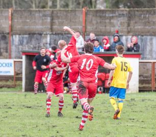 Josh Ryall celebrates with his teammates after scoring the eventual winner for Ton Pentre.