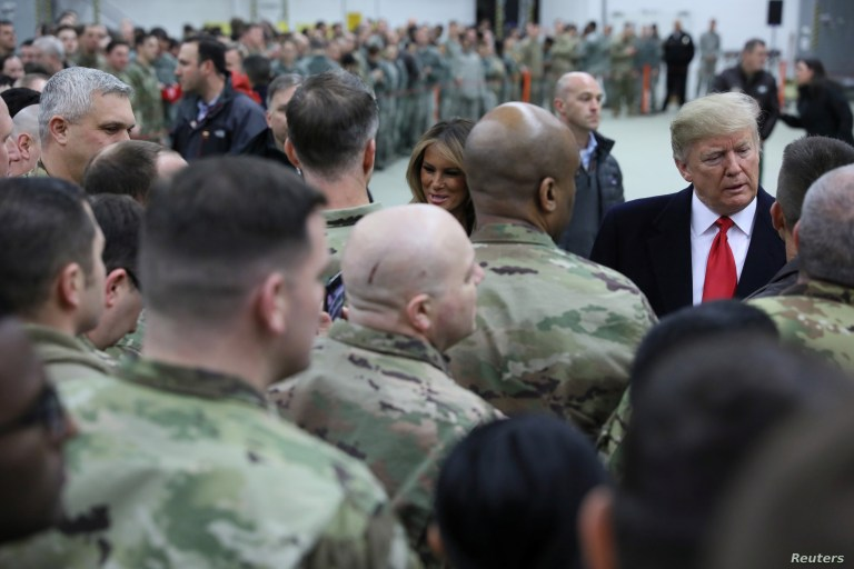 FILE - U.S. President Donald Trump and first lady Melania Trump greet U.S. troops at Ramstein Air Force Base, Germany, Dec. 27, 2018.