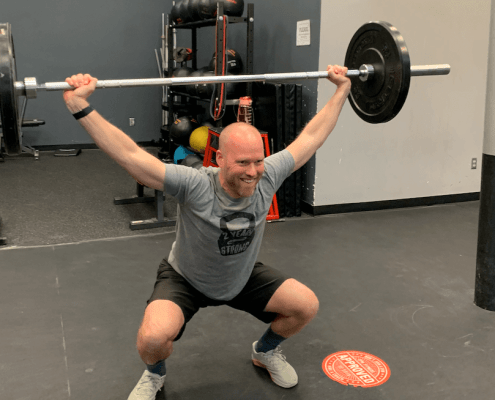 CPM member performing snatch