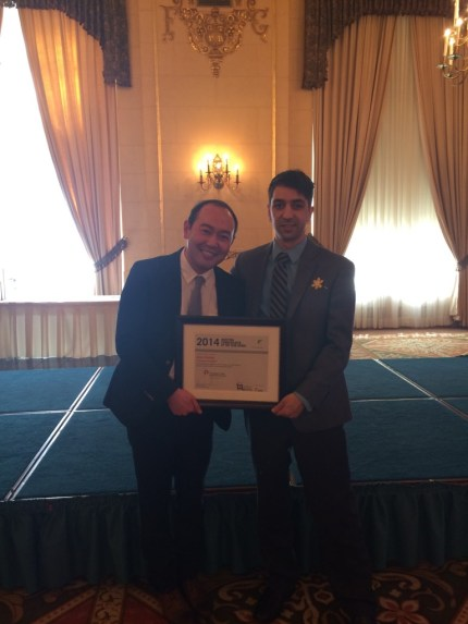 Jason Syvixay (left) accepts the award from chapter President Jason Permanand (right).