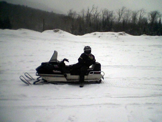 Jo taking a break on her Arctic Cat