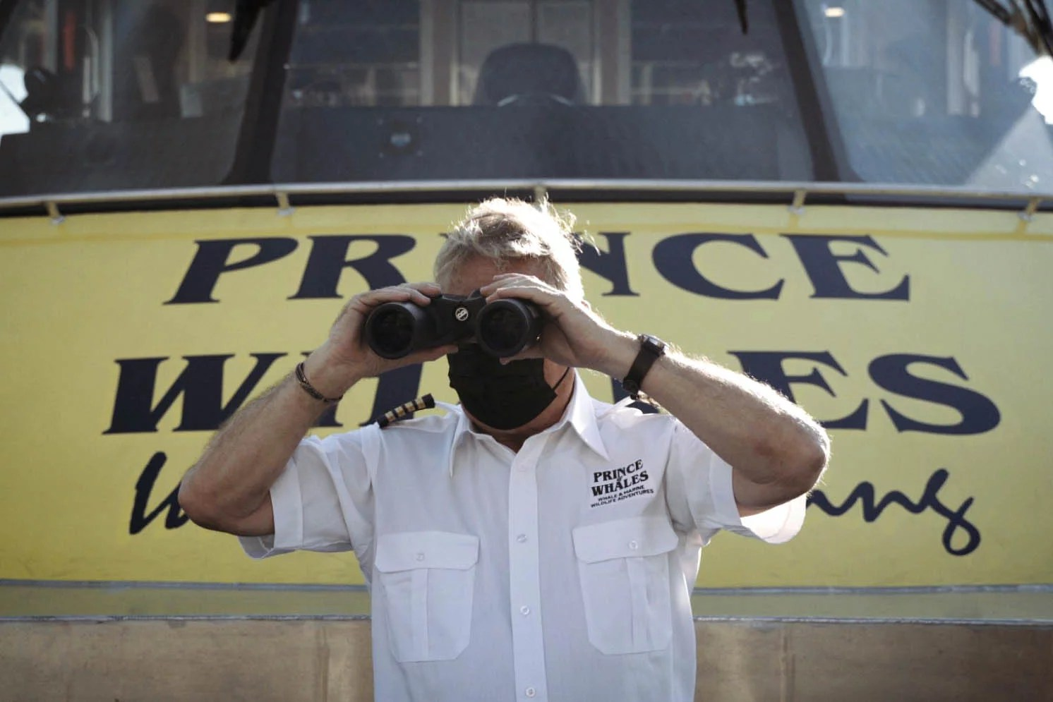 Captian looking our of binoculars