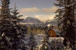 Barn in snow and Rockies