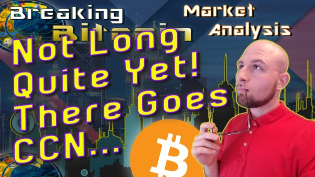 text not long quite yet! There goes CCN next to just with glasses on lip looking up into distance pontificating with graphic background and bitcoin logo