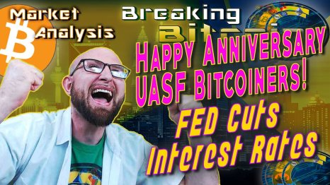 text happy anniversary uasf bitcoiners! FED cuts interest rates net to super happy screaming justin with both fists raised in happy excitement with architecture city skyscraper background graphic and bitcoin logo