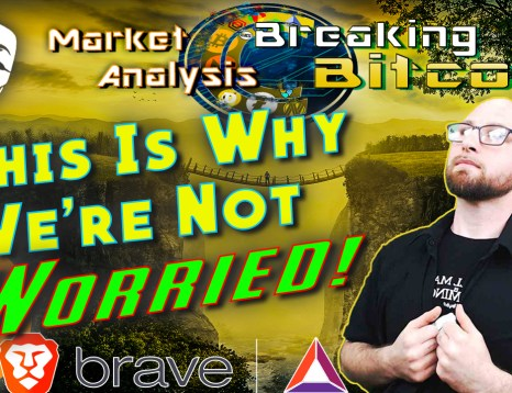 Text this is why we're not worried next to justin holding shirt looking up sternly confident with anonymous mask in top corner, brave browser and bat logo at bottom and graphic background of landscape with two seperate lands and man standing on bridge between them with bitcoin logo