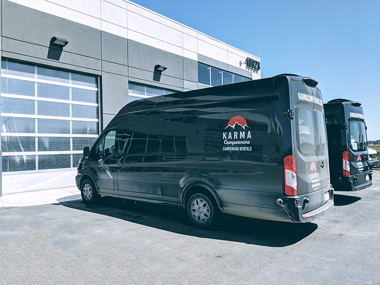 Karma Campervans Location In Calgary With 2 Vans Parks Outside