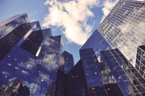 Skyscrapers, viewed looking up.