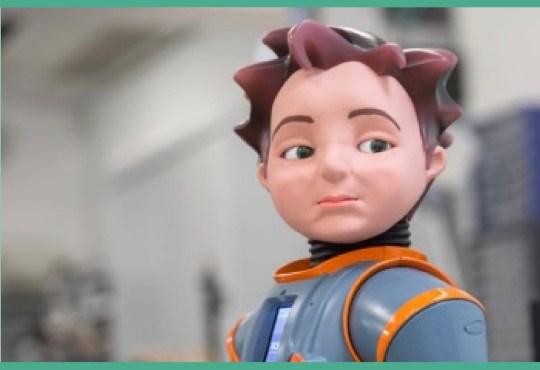 A boy-like robot looks over his shoulder.
