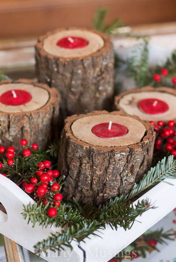 Group the rustic wood candle holders with greenery and berries for perfect holiday centerpiece.