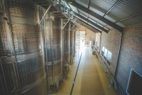 A row of fermentation tanks at Loxtonia Cider, Ceres, South Africa
