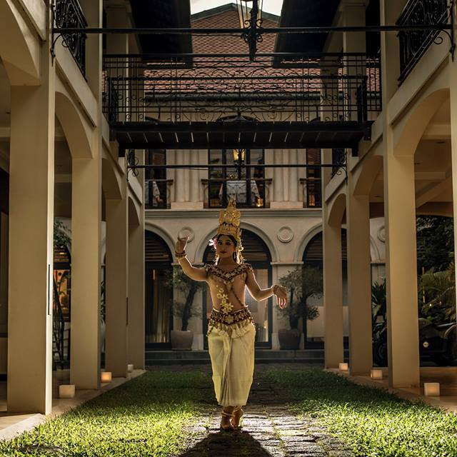 Heritage Suites Hotel luxury travel public relations case study - Apsara Dancer, a lady standing in the middle of the courtyard. A picture of symmetry