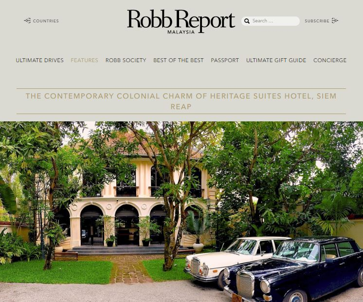 Heritage Suites Hotel luxury travel pr case study media coverage - Robb Report, Malaysia; two vintage mercedes benz cars parked next to luxury hotel with colonial facade shrouded in greenery