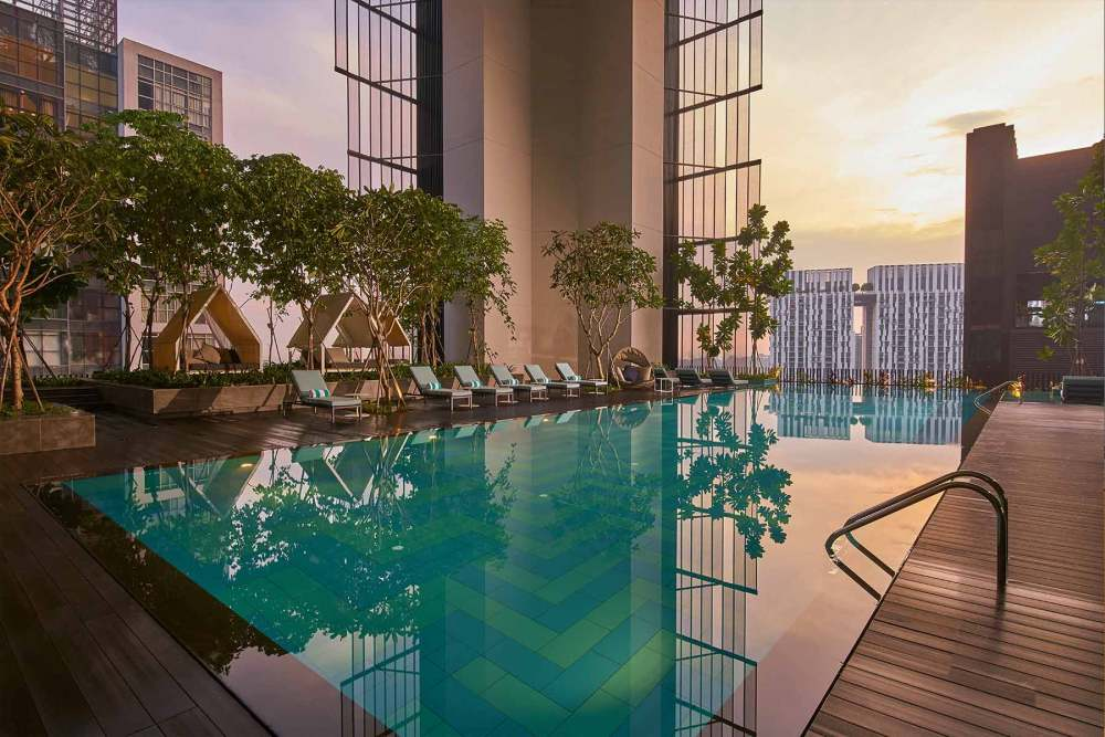 Staycation in Singapore during Phase 2 at the Oasia Hotel Downtown. Club Infinity Pool at sunset