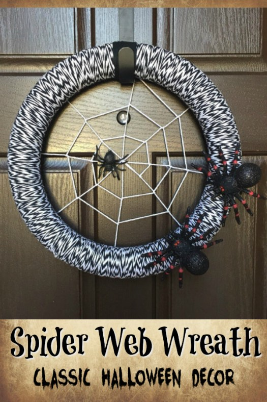 Classic Halloween wreath. This yarn-wrapped spider web wreath is perfect for Halloween! Check out all of craft evangelist's wreath finds for every month of the year!